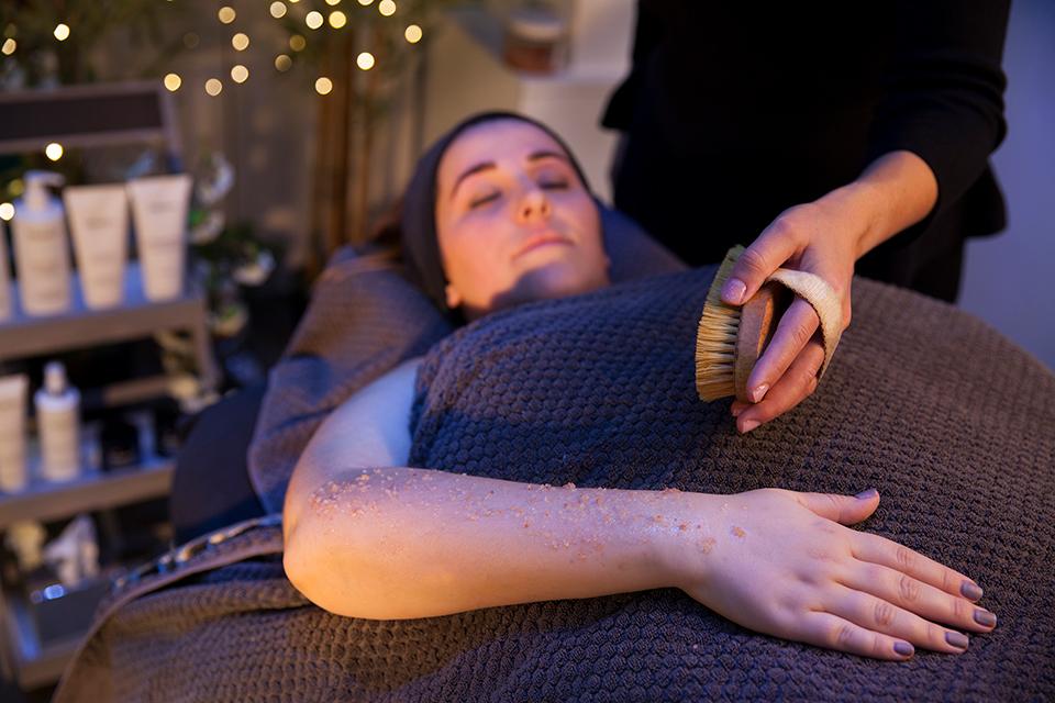 Decorative image showing a body scrub treatment